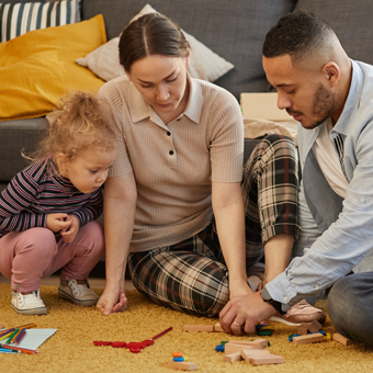 Full length portrait of happy modern family playing with cute little girl in cozy home interior, copy space